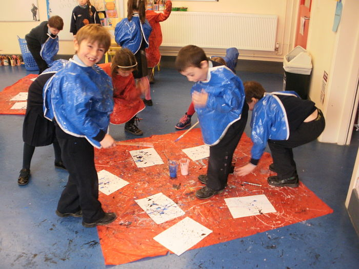 Senior Infants having fun painting like Jackson Pollock